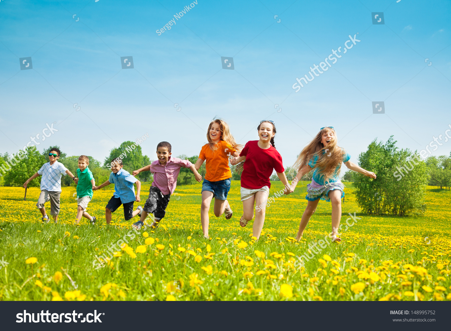 stock-photo-group-of-seven-running-in-the-park-kids-boys-and-girls-black-and-caucasian-148995752